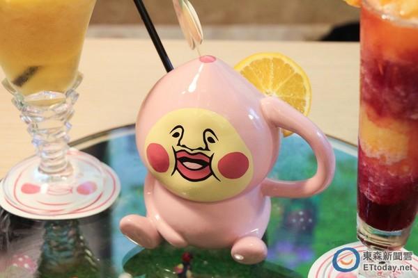 可爱造型的饮料杯.(粉屁桃最爱水蜜桃苹果茶)