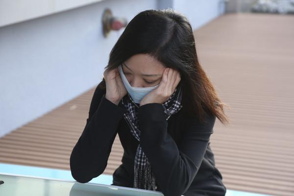頭痛,感冒,發燒,脖子痛,頸部僵硬。(圖/記者黃克翔攝)